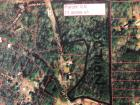 11 acres, more or less located at 752 Knopf Drive, Warrior, Alabama.