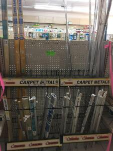 Display with contents: Carpet bars & clamps