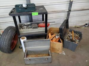 Cart with contents: small bin of misc sockets, small box of misc tools, tire with rim, old straps, nuts, bolts, misc
