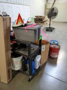 Cart with misc contents plus floor items: buckets with contents, letters for sign, fluoresent bulbs,