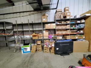 All shelves with contents: dyrer duct, cleaning supplies, old non working TV, misc hoses
