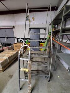 Rolling Warehouse Ladder and hand truck handle