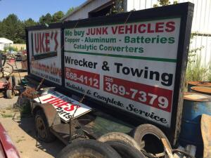 Woodframed ad sign with trailer and ramps. Sign is 19' x 6' with lights. Trailor is 18'
